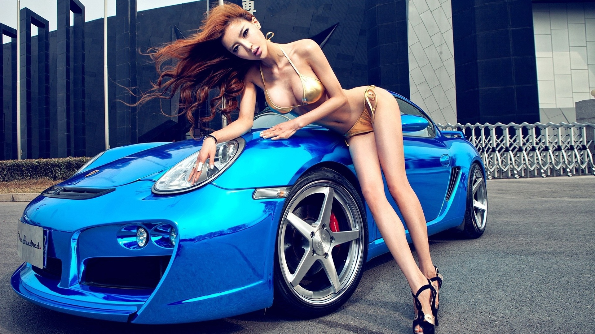 Busty anorexic asian beauty in bikinis and Porsche 911 ...
