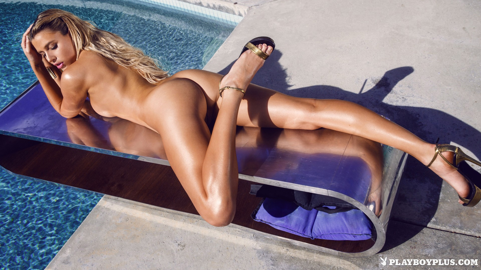 tanning Nude by the pool blondes