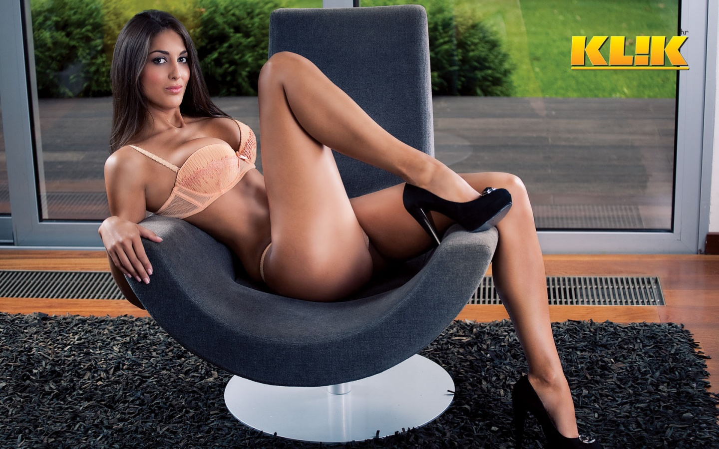 sexy girl pose in hot peach lingerie with hot slim long legs and