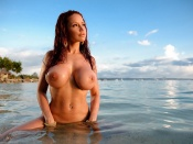 Bianca Beauchamp taking a bath topless