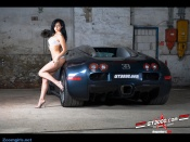 Sexy brunette lingerie model next to Bugatti Veyron