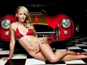 Hot blonde in tiny bikini and AC Cobra
