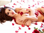 Isis Taylor nude in a bed of roses