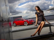 The 2010 new Opel Astra Gtc and one hot babe wallpaper