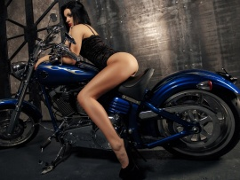 Stunning brunette and chopper (click to view)