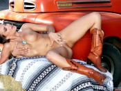 Teal Conrad erotic photo with a car
