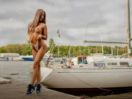 Topless babe and boats (click to view)