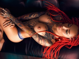 Topless inked redhead (click to view)