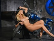 Yarina A nude next to a Harley Davidson Bike