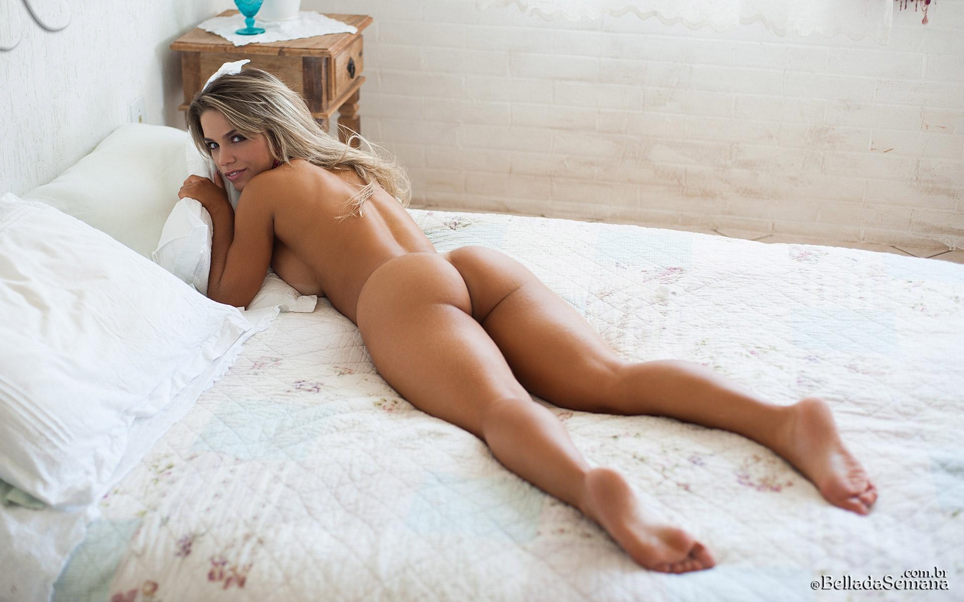 Amanda Sagaz hot brazilian ass spread over a white bed ...