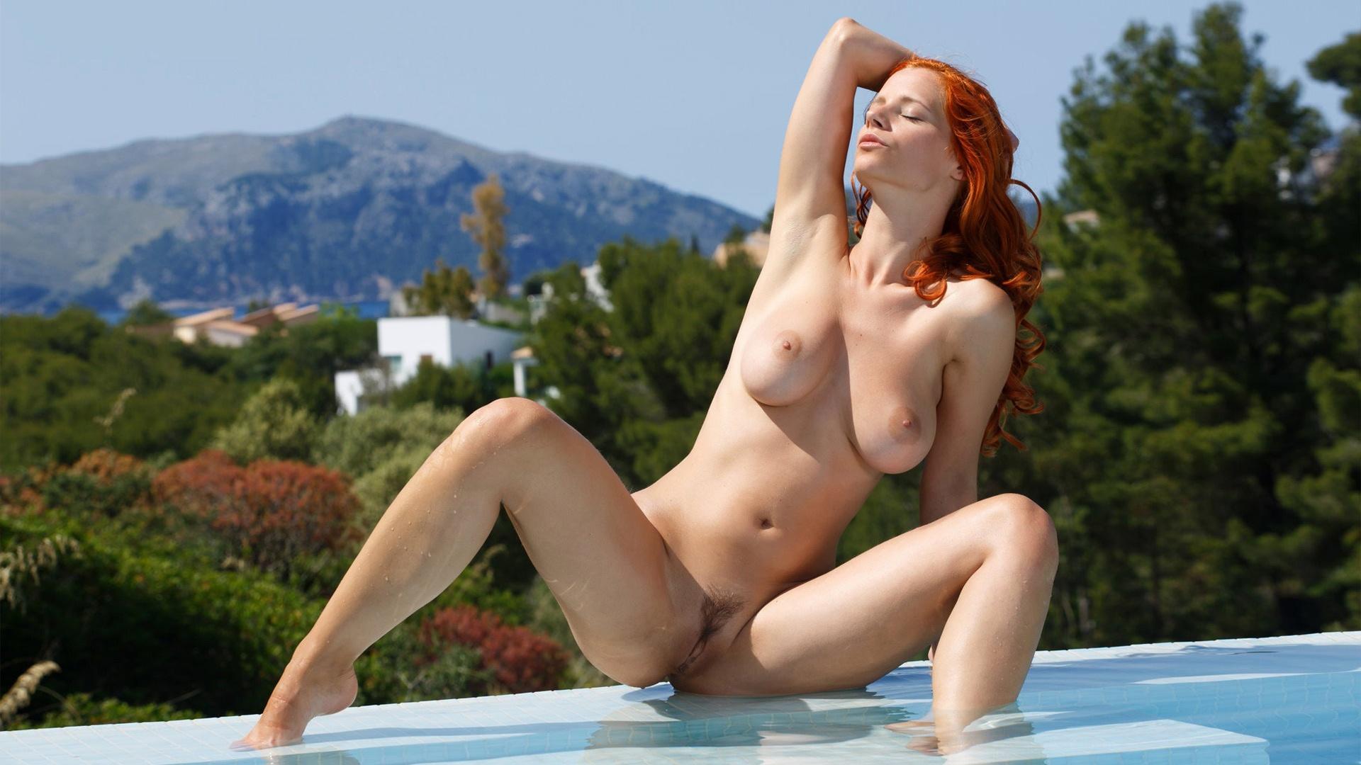busty redhead pornstar showing pussy